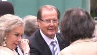 Exterior shots Sir Roger Moore Actor Christina 'Kiki' Tholstrup wife greeting guests at the Michael Winner memorial service Sir Roger Moore at...