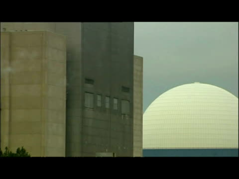 exterior shots Sizewell Nuclear Power Facility surrounding coastline interior shots workers inside main reactor hall with various tanks pipes coolers