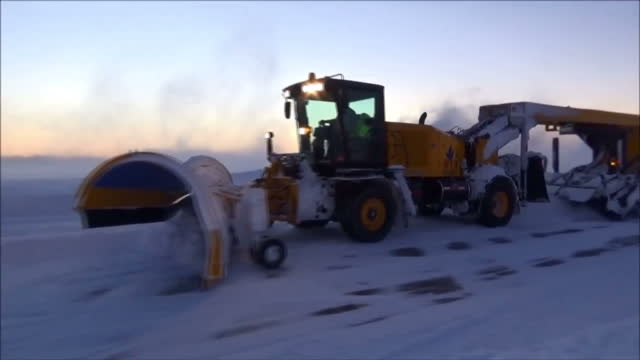 Exterior shots snow clearing machines clearing snow from the runways at Washington Dulles International Airport after Winter Storm Jonas hit the US...