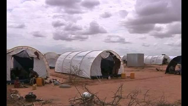 Exterior shots Somalian refugees arriving at Camp Dadaab Exterior shots makeshift camps with refugees erecting shelters Exterior shots refugees...