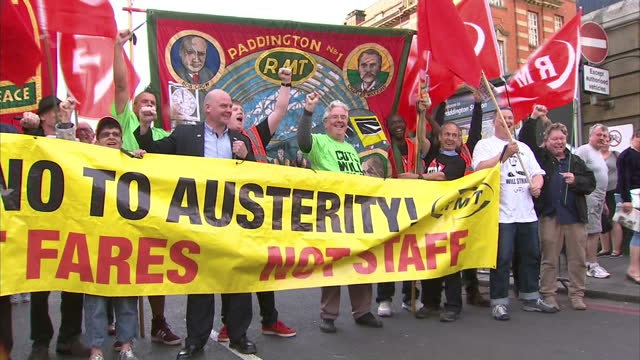 Exterior shots Steve Hedley RMT Union Assistant General Secretary and RMT union members protesting against austerity cuts holding banner reading 'No...