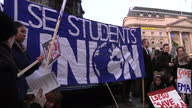Exterior shots students protesting in Picadilly Circus waving banners placards in response to cuts in EMA funding EMA Student Protests in London on...
