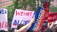 Exterior shots supporters of different New York mayor candidates holding up placards for John Liu Anthony Weiner Supporters With Placards For Mayoral...