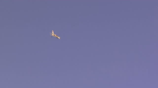 Exterior shots Syrian army plane flying across Aleppo city dropping bombs on targets Exterior shots crater from bomb aftermath Syrian Army Air...