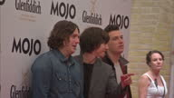 Exterior shots the Arctic Monkeys pose for the press on the red carpet at the Mojo Awards Arrivals Arctic Monkeys on the Red Carpet at the Mojos on...