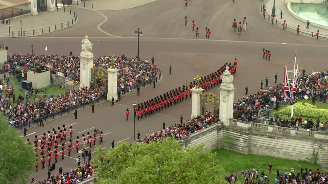 Exterior shots The Marching Band of the Welsh Guard marching on The Mall around the Victoria Memorial Sky News Royal Wedding Celebration Footage at...