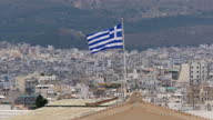 Exterior shots The Old Royal Palace home of the Greek parliament with the Greek flag blowing in wind on top of the building on June 30 2015 in Athens...