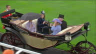 Exterior shots The Queen Prince Philip Prince Andrew drive out from Royal enclosure in horse drawn carriage wave as they pass the crowds Exterior...