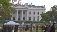 Exterior shots The White House with tourists walking around outside and looking at statues and the American flag blowing in wind on November 09 2016...