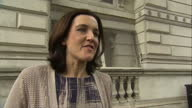 exterior shots Theresa Villiers Secretary of State for Northern Ireland depart Downing Street onto Whitehall and comments about first Conservative...