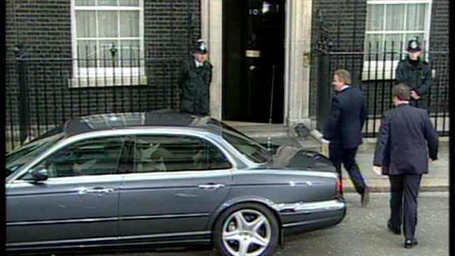 Exterior shots Tony Blair and Cherie Blair arrive at 10 Downing Street wave to press on May 06 2005 in London United Kingdom