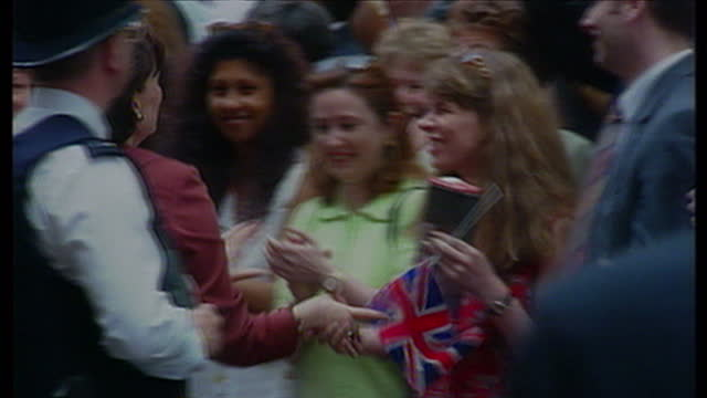 Exterior shots Tony Blair wife Cherie Blair waving to crowds on Downing St on May 2nd 1997 in London United Kingdom