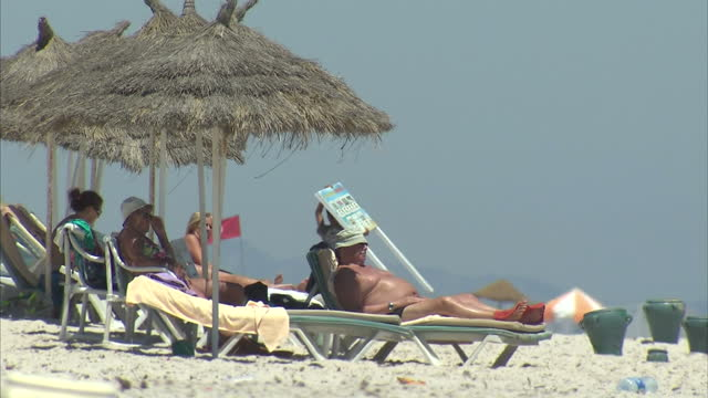 Exterior shots tourists relaxing on beach where Sousse hotel terror attack took place on June 30 2015 in Sousse Tunisia
