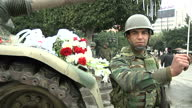 Exterior shots Tunis street scenes with soldiers security forces and tank with flowers laid on it on January 25 2011 in Tunis Tunisia