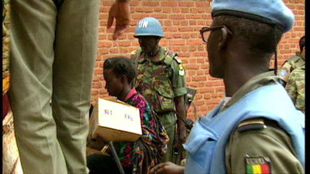 Exterior shots UN soldiers loading Rwandan refugees into back of truck evacuating them from areas of unrest on June 16 1994 in Various Cities Rwanda