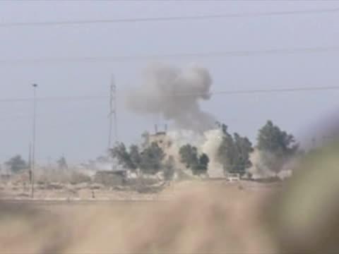 exterior shots US Marines fire on enemy positions near Umm Qasr firing a Javelin antitank missile Exterior shot Javelin missile hitting Iraqi...