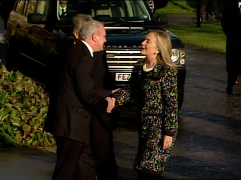Exterior shots US Secretary of State Hillary Clinton is welcomed to Stormont and poses with Martin McGuinness Peter Robinson Loyalist Rioting...