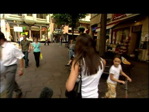exterior shots Vanessa Perroncel walk with Carly Zucker and unknown man through Baden Baden Exterior shots of Sky News reporter Ian Dovaston...