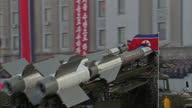 Exterior shots various North Korean missiles are displayed on back of military vehicles during Workers Party 70th Anniversary Military Parade on...