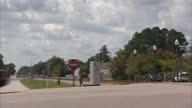 Exterior shots Vehicles driving over railroad level crossing on 19th October 2012 in Dillon South Carolina USA