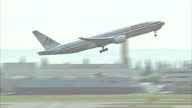 Exterior shots Virgin Atlantic Airbus A340 taxis on runway Exterior shot row of Virgin Atlantic tail fins Exterior shot American Airlines Boeing 777...