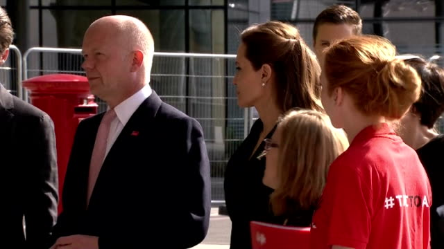 Exterior shots William Hague Angelina Jolie and Brad Pitt arrive at End Sexual Violence in Conflict Zones Summit on June 10 2014 in London England