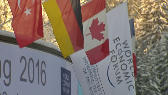 Exterior shots world flags hanging outside the building hosting the 2016 World Economic Forum Snow covered trees in background on January 21 2016 in...