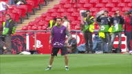 Exterior shots Xavi training with Barcelona squad at Wembley stadium ahead of the 2011 UEFA Champions League Final on May 27 2011 in Wembley England