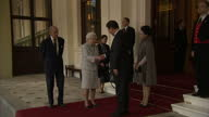 Exterior shots Xi Jinping Chinese President and Peng Liyuan Chinese First Lady leaving Buckingham Palace shake hands with Queen Elizabeth II and...