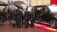 Exterior shots Xi Jinping Chinese President and Prince William Duke of Cambridge are shown a Zeroemission prototype of a classic London taxi and red...