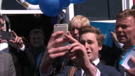 Exterior shots young activist taking selfie photo with Boris Johnson Exterior shots Boris Johnson Mayor of London campaigning with Craig Mackinlay in...