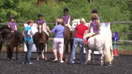 Exterior shots Zara Phillips chats with group of young girls mounted on ponies Exterior shots Zara Phillips oversees dressage training session Zara...