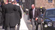 Exterior shots Zara Phillips gets out of car in wedding dress veil designed by Stewart Parvin walks into Canongate Kirk church escorted by her father...