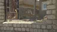 Exterior shows destroyed buildings and property near Mosul lots of scattered rubble
