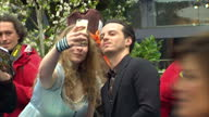 Exterior shows of actor Andrew Scott signing autographs and posing for selfies on the red carpet at the European Premiere of Alice Looking Through...