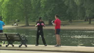 Exterior shows people sparring boxing training by banks of the Serpentine