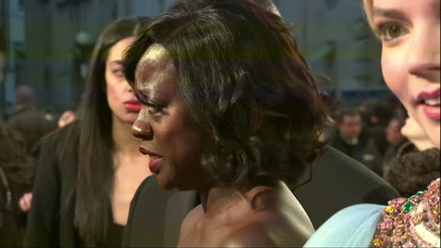 Exterior side view night shot of Viola Davis actress in Fences film speaking to press on red carpet smiling etc at the BAFTA Awards at the Royal...