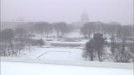 Exterior timelapse Capitol Hill with United States Capitol Building in background as snow storm sets in on in Washington United States