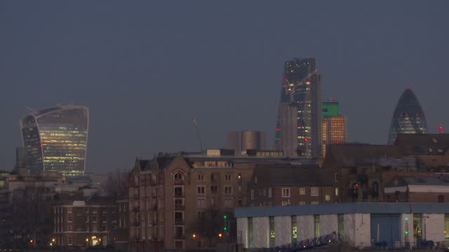 Exterior timelapse shots of the sun rising over the River Thames and City of London with Tower Bridge Walkie Talkie and Swiss Re buildings on the...