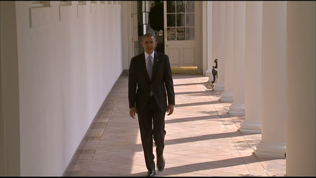 Exterior top shot of President Barack Obama walking through an outdoor corridor in the White House President Barack Obama in the White House at The...