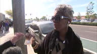 Exterior voxpop w/ woman speaking on how she would spend her winnings