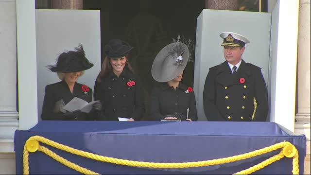 Exterior wide shot Camilla Duchess of Cornwall Catherine Duchess of Cambridge Sophie Countess Wessex Commander Tim Lawrence stand on balcony...