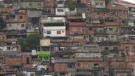 Exterior wide shot towering flavelas slum shanty town area in Brazil Flavelas in Brazil on June 24 2013 in Rio de Janeiro Brazil