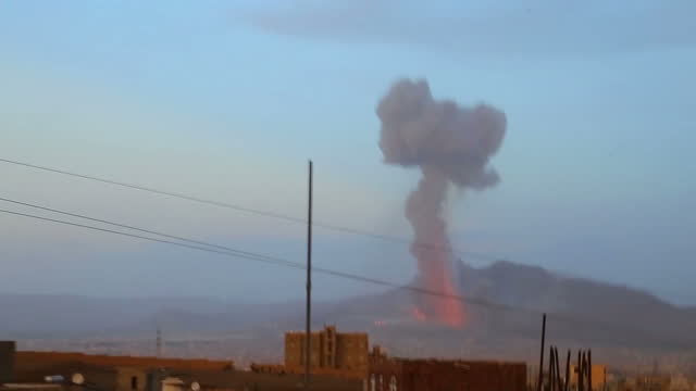 Exterior wide shots explosions in distance on June 15 2015 in Sana'a Yemen