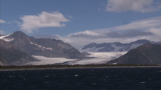 Exterior wide shots mountains and glaciers in Kenai Fjord National Park seen from boat on September 01 2015 in Seward Alaska