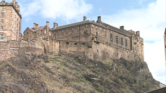 Exterior wide shots of Edinburgh Castle and close up shots of canons and a Union Jack flag flying on the castle on June 26 2015 in Edinburgh Scotland