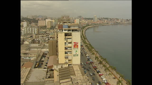 Exterior wide shots of Luanda harbour and bay with the city and traffic in the background and the sunset on August 21 2001 in Angola