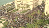 Exterior wide shots of protesters gathered in crowds of thousands to protest in against President Hosni Mubarak's government on February 2 2011 in...
