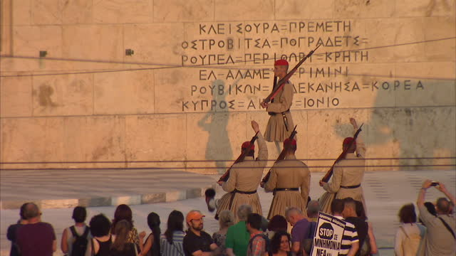 Exterior wide shots of protesters gathering outside the Hellenic Parliament building rallying against austerity measures on July 10 2015 in Athens...