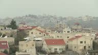 Exterior wide shots of residential areas houses with solar panels on rooftops on February 15 2017 in Beit El Binyamin Region of the West Bank Israel